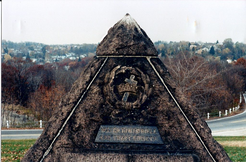 Pyramid near Charles Taze Russell's tombstone with crown and cross